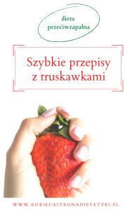 ręka trzymająca truskawkę